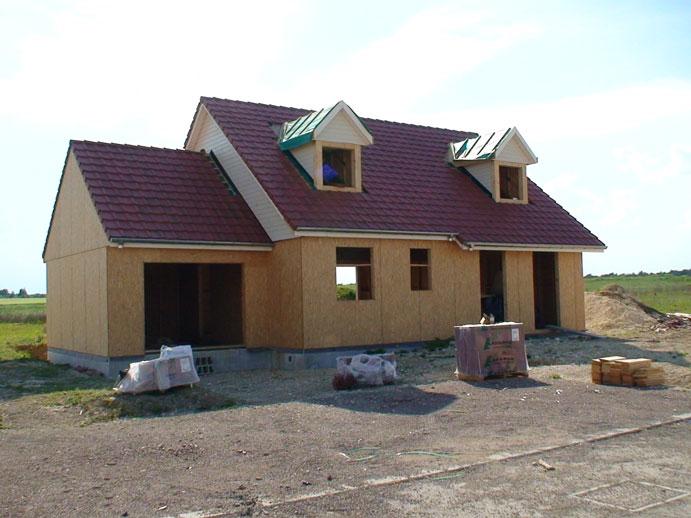 i la charpente et fin histoire singuli re construction d une maison ossature bois. Black Bedroom Furniture Sets. Home Design Ideas